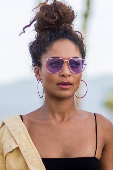 woman with top knot and purple sunglasses