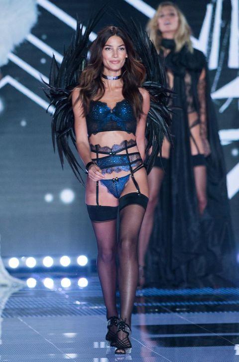 Human body, Fashion model, Fashion show, Black hair, Fashion, Thigh, Long hair, Model, Runway, Costume,