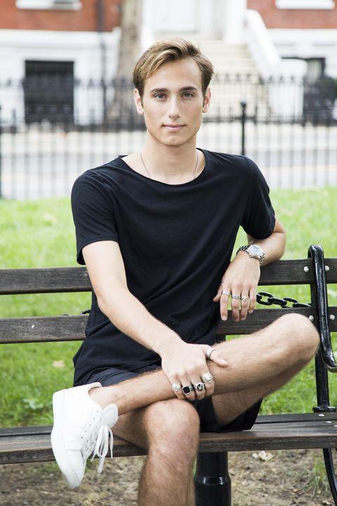 Sitting, T-shirt, Leg, Fashion, Beauty, Footwear, Street fashion, Model, Human leg, Arm,