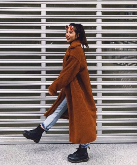 Clothing, Street fashion, Outerwear, Footwear, Orange, Fashion, Brown, Standing, Coat, Shoe,