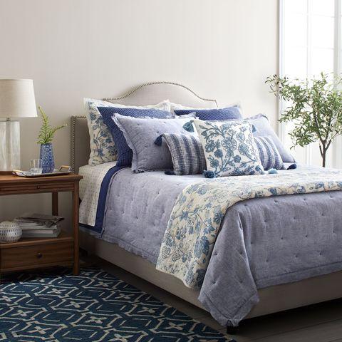 Blue, Room, Interior design, Bedding, Textile, Wall, Bed, Bedroom, Furniture, Bed sheet,
