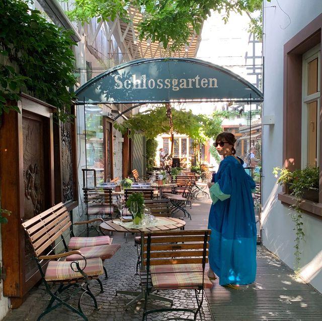 Outdoor furniture, Outdoor table, Door, Shade, Flowerpot, Umbrella, Courtyard, Houseplant, Patio, Home door,