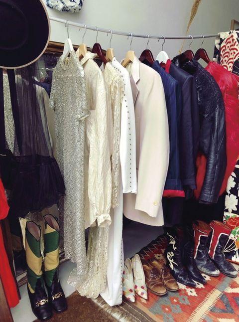Room, Clothes hanger, Fashion, Collection, Retail, Fashion design, Home accessories, Boutique, Boot, Shoe organizer,