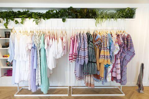 Clothes hanger, Room, Pink, Boutique, Textile, Furniture, Closet, Home accessories, Wardrobe,