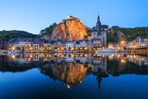 the citadel, the collegiate church and the meuse river at dinant, belgium