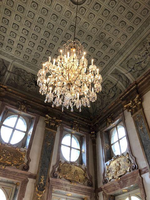 Ceiling, Chandelier, Ceiling fixture, Lighting, Light fixture, Holy places, Architecture, Interior design, Building, Room,