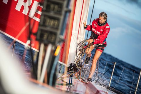 Red, Vehicle, Recreation, Team, Human leg, Sailing, Competition event, Watercraft, Championship, Boat,