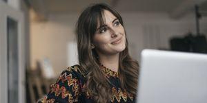 Pretty woman using laptop