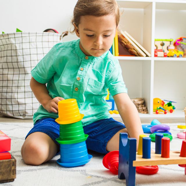 4 year old boy playing with building toys