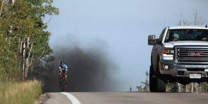 Truck rolls coal on cyclist