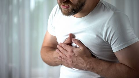 40s man feeling strong chest pain, heart attack caused by stress, cardiology