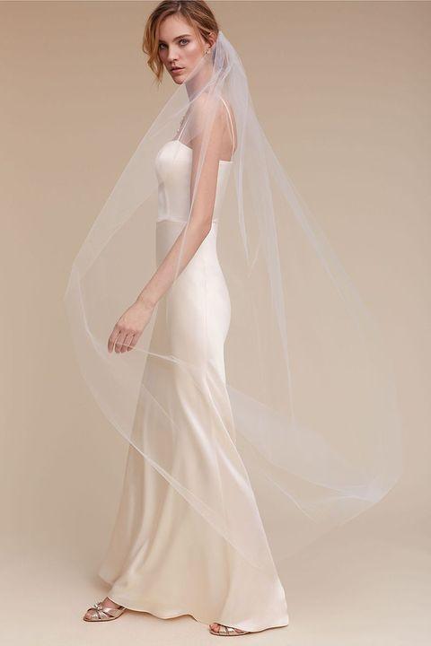 Wedding dress, Gown, Bridal accessory, Dress, Clothing, Veil, Bridal party dress, Bridal clothing, Shoulder, Bridal veil,