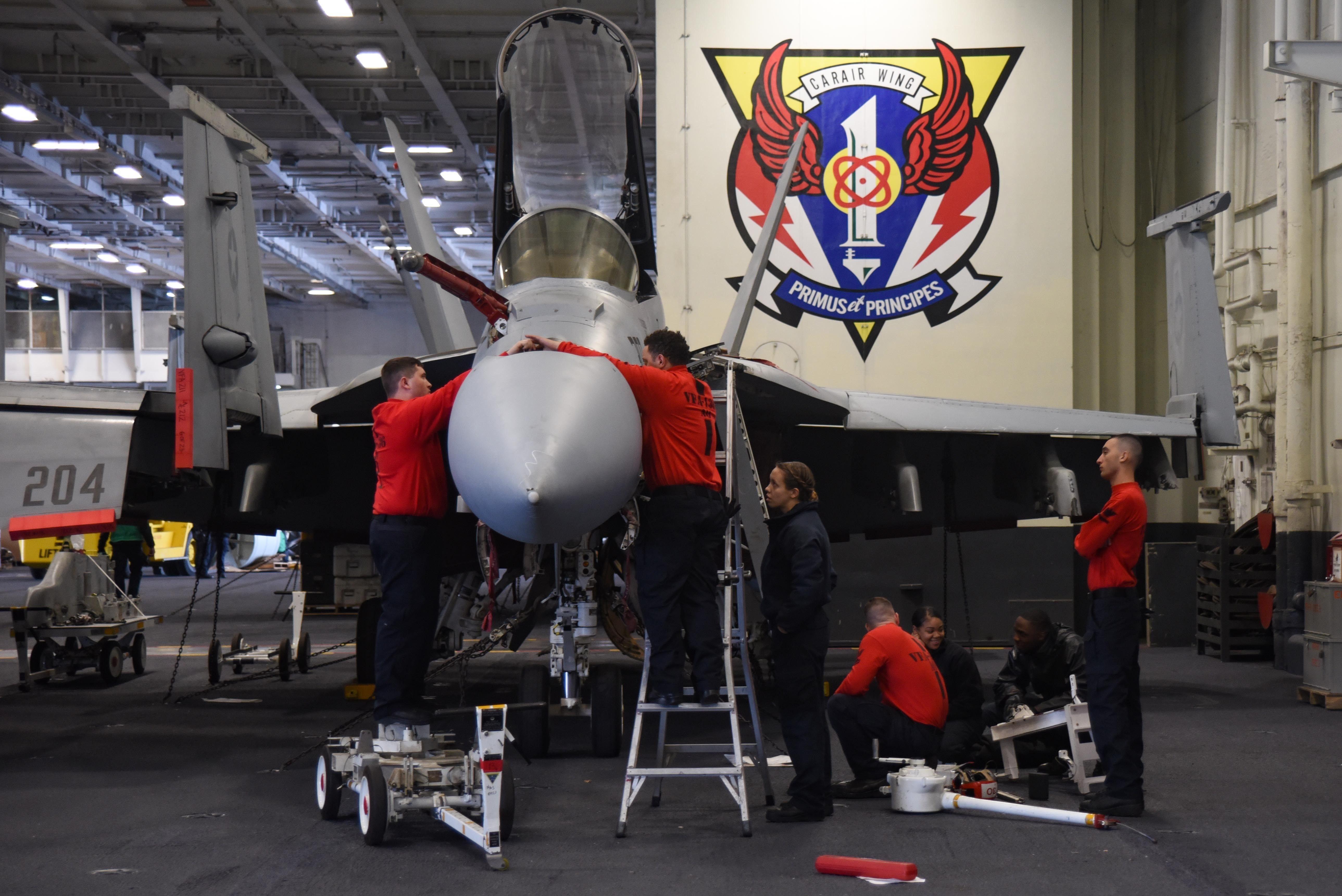 Sailors Conduct Maintenance On A F/A-18F Super Hornet