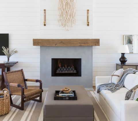 Living room, Room, Furniture, Interior design, Fireplace, Hearth, Property, Table, Wall, Home,