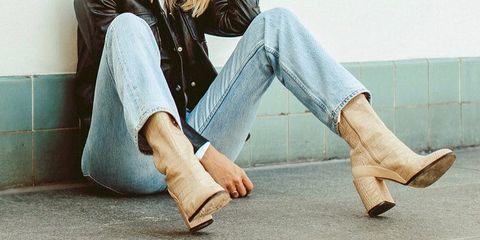 Jeans, Sitting, White, Denim, Blue, Clothing, Blond, Leg, Footwear, Beauty,