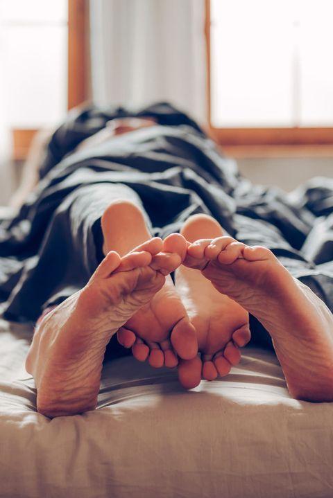 Photograph, Bed, Room, Bed sheet, Hand, Leg, Bedroom, Furniture, Bedding, Floor,