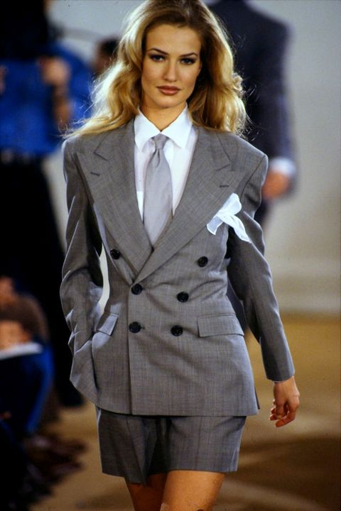 Fashion model, Clothing, Fashion, Fashion show, Suit, Outerwear, Formal wear, Hairstyle, Long hair, Coat,