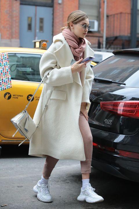Street fashion, Clothing, Fashion, Footwear, Yellow, Snapshot, Trench coat, Pink, Coat, Outerwear,
