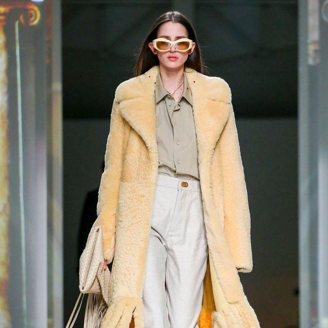 Fashion, Fashion model, Fashion show, Runway, Clothing, Fur, Haute couture, Yellow, Outerwear, Fur clothing,