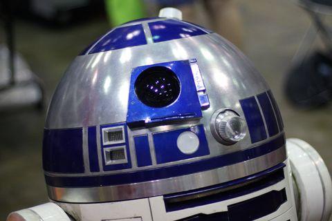 R2-d2, Fictional character, Helmet, Robot, Technology, Motorcycle helmet, Machine,