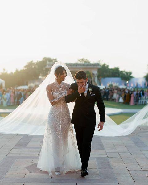 Photograph, Wedding dress, Bride, Dress, Gown, Bridal clothing, Ceremony, Veil, Wedding, Yellow,