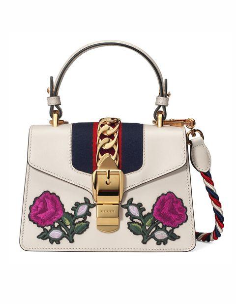 Handbag, Bag, Shoulder bag, Fashion accessory, Fashion, Beige, Coin purse, Material property, Magenta, Buckle,
