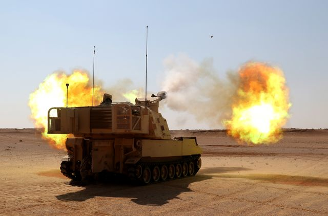 mohamed naguib military base, egypt – a m109 paladin from alpha battery, 2nd battalion, 114th field artillery regiment, 155th armored brigade combat team, task force spartan, fires a high explosive round during the combined arms lived fire exercise, part of bright star 18 us army photo by staff sgt matthew keeler