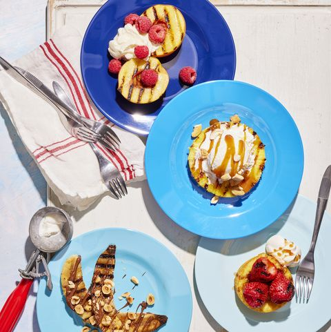 grilled fruit desserts and ice cream served on blue plates in various shades