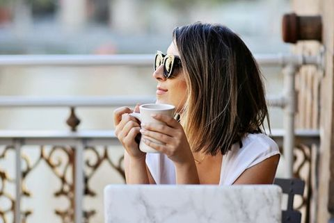 Photograph, Shoulder, Sitting, Beauty, Street fashion, Glasses, Drinking, Eyewear, Joint, Coffee cup,