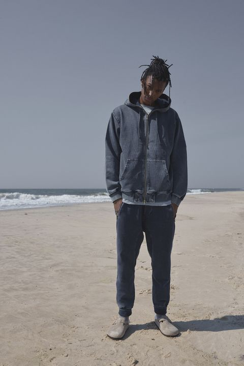 Beach, Sand, Standing, Jeans, Outerwear, Vacation, Sea, Human, Hoodie, Coast,