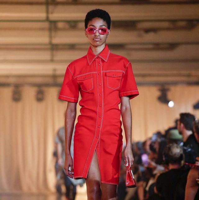 Fashion model, Fashion show, Fashion, Runway, Clothing, Fashion design, Red, Shoulder, Footwear, Public event,