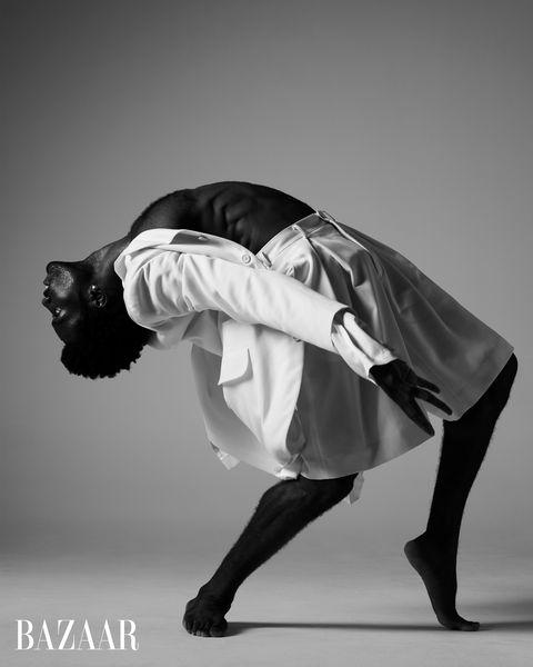 vinson fraley, jr leaning back in skirt black and white
