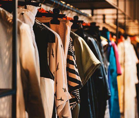 Clothes hanger, Clothing, Street fashion, Fashion, Boutique, Room, Outerwear, Closet, Fashion design, Textile,