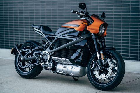 Land vehicle, Motorcycle, Vehicle, Car, Automotive exhaust, Rim, Automotive design, Exhaust system, Spoke, Headlamp,