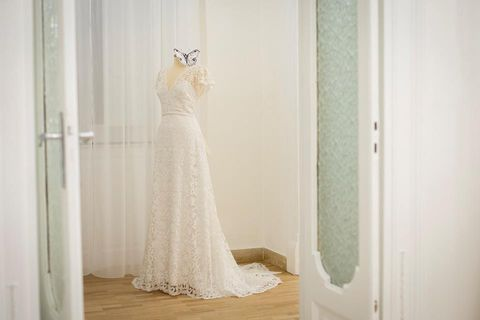Wedding dress, Dress, Photograph, Clothing, White, Gown, Bridal clothing, Bridal party dress, Bride, Bridal accessory,