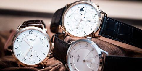 Watch, Analog watch, Watch accessory, Fashion accessory, Strap, Brand, Jewellery, Silver, Material property, Clock,