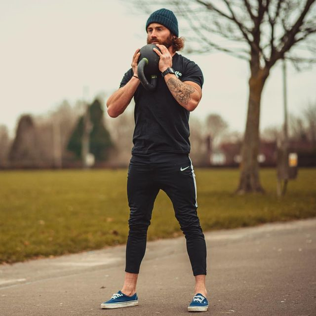 Sportswear, Street fashion, Standing, Jogging, Recreation, Trousers, Cap, Physical fitness, Muscle, Shoe,