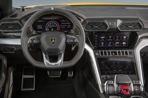 Land vehicle, Vehicle, Car, Center console, Steering wheel, Gear shift, Automotive design, Supercar, Luxury vehicle, Steering part,