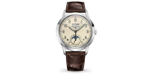 Watch, Analog watch, Watch accessory, Strap, Fashion accessory, Jewellery, Brown, Brand, Material property, Font,