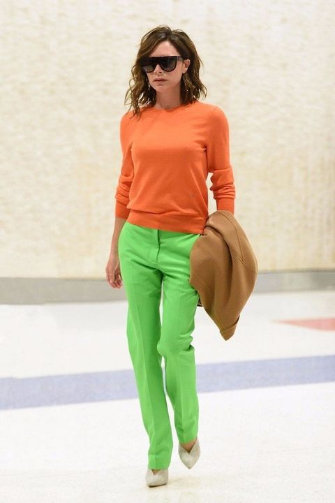 Clothing, Orange, Green, Fashion model, Fashion, Shoulder, Yellow, Fashion show, Eyewear, Neck,