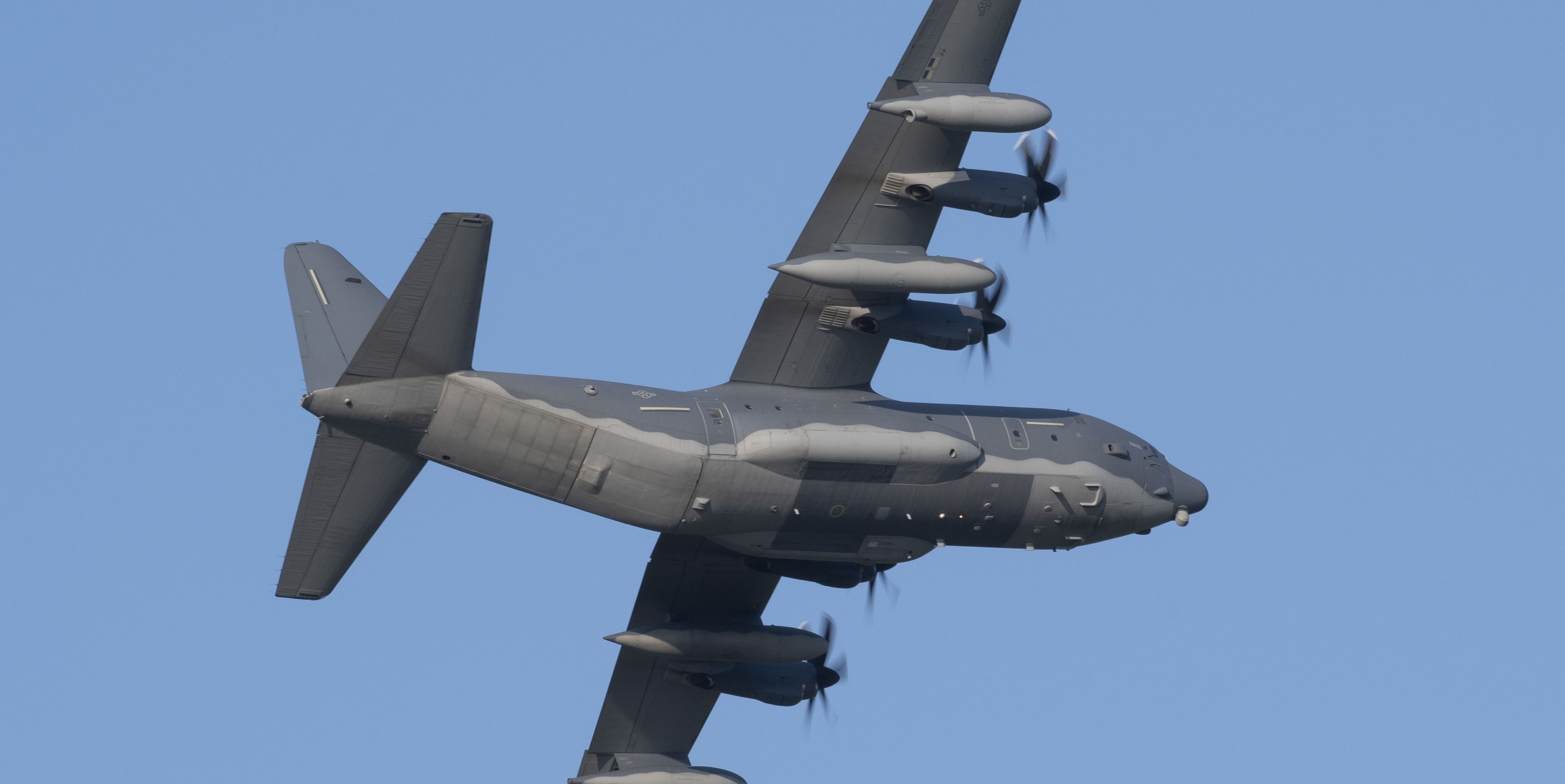 Watch Four Air Force Transports Thread Through a Valley