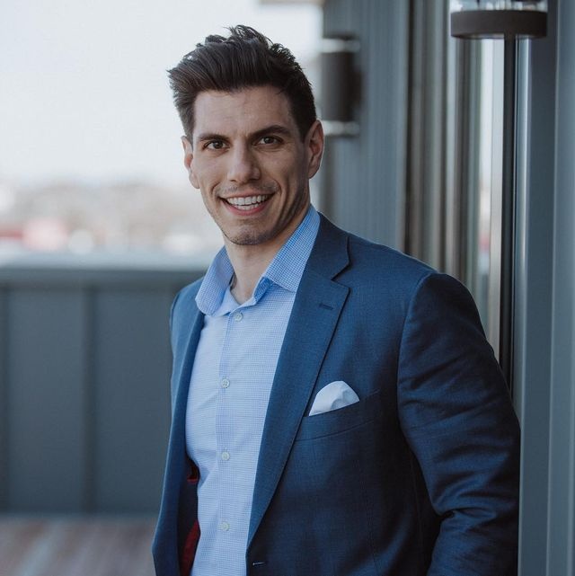peter giannikopoulos in a blue suit