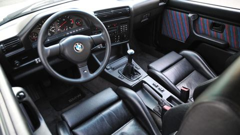 Land vehicle, Vehicle, Car, Steering wheel, Center console, Bmw, Sports car, Coupé, Personal luxury car, Sedan,