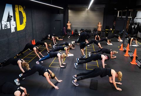 group of people doing push ups