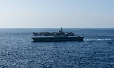 190619 n pj626 0004 south china sea june 19, 2019 us navy forward deployed aircraft carrier uss ronald reagan cvn 76 sails alongside japan maritime self-defense force helicopter destroyer js izumo ddh 183 While conducting operations in the south china sea ronald reagan, the flagship of carrier strike group 5, provides a combat-ready force that protects and defends the collective maritime interests of its allies and partners in the indo-pacific region us navy photo by Mass Communication Specialist 2nd Class Kaila Peters