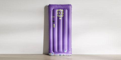 purple 'friends' door pool float leaning against wall