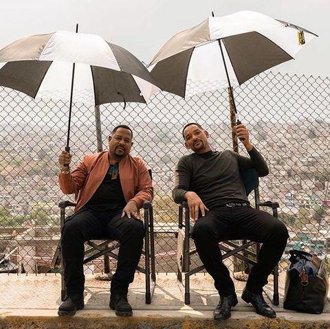 Umbrella, Fashion accessory, Tree, Shade, Sitting, Tourism, Photography, Furniture, Leisure,