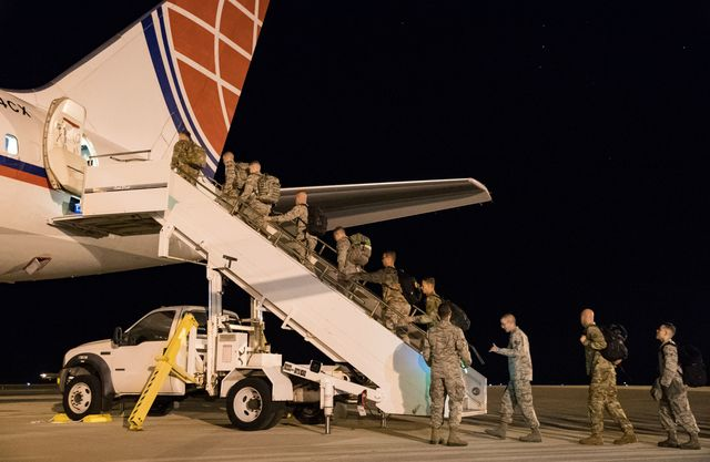 """team dover members use the step truck to enter the passenger seating section of an air transport international boeing 757 200 sept 8, 2019, at dover air force base, del the ati aircraft, part of the civil reserve air fleet program, was contracted to transport cargo and 30 team dover members to fairchild afb, wash, participating in mobility guardian 2019 """"air mobility command's commercial airlift partners are a vital part of our daily airlift missions around the world as well as our wartime effort,"""" said maj adam crane, amc headquarters craf branch chief, scott afb, ill us air force photo by roland balik"""