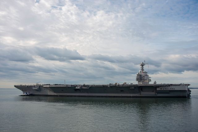 newport news, va oct 25, 2019   tugs direct the bow of uss gerald r ford cvn 78 into the james river as it gets underway ford departed huntington ingalls industries newport news shipbuilding and returned to sea for the first time since beginning its post shakedown availability in july 2018 to conduct sea trials us navy photo by mass communication specialist 3rd class tatyana freeman
