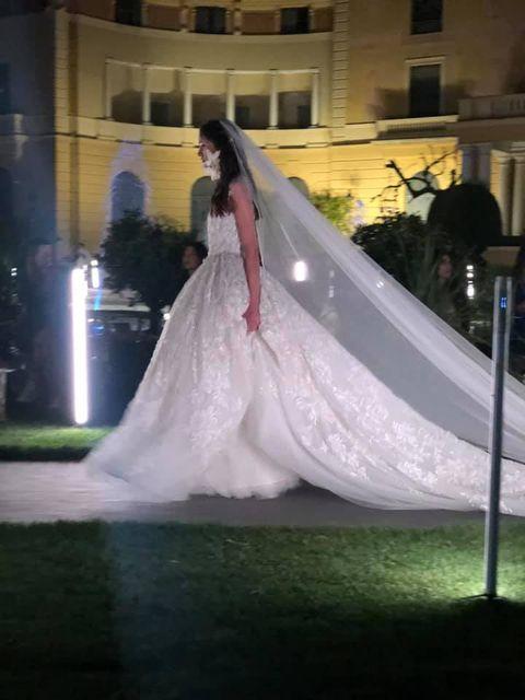 Wedding dress, Gown, Dress, Bride, Veil, Bridal accessory, Clothing, Bridal clothing, Bridal veil, Haute couture,